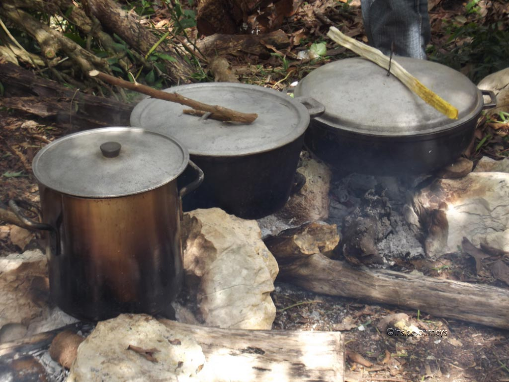 Three large pots with dinner, Jamaica