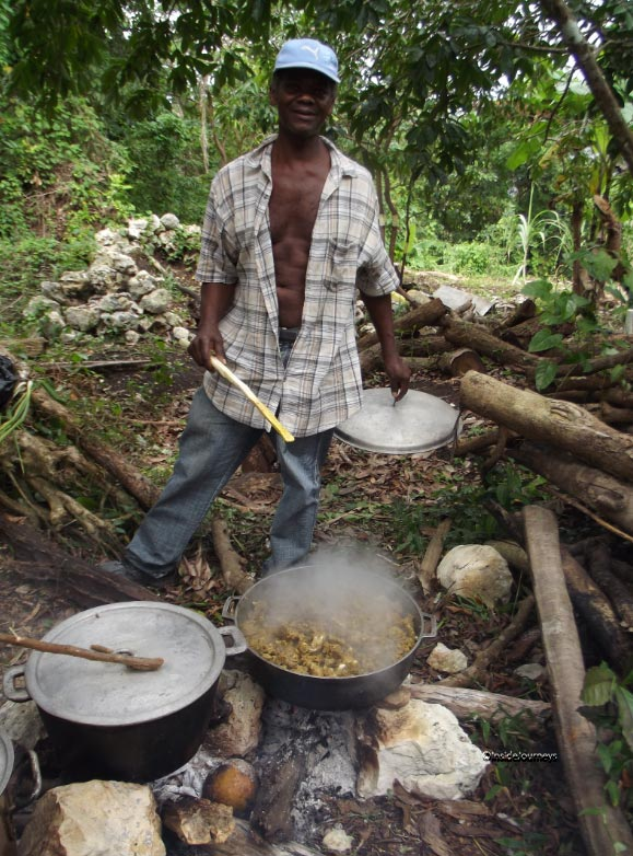 Man checking curried goat, Jamaica