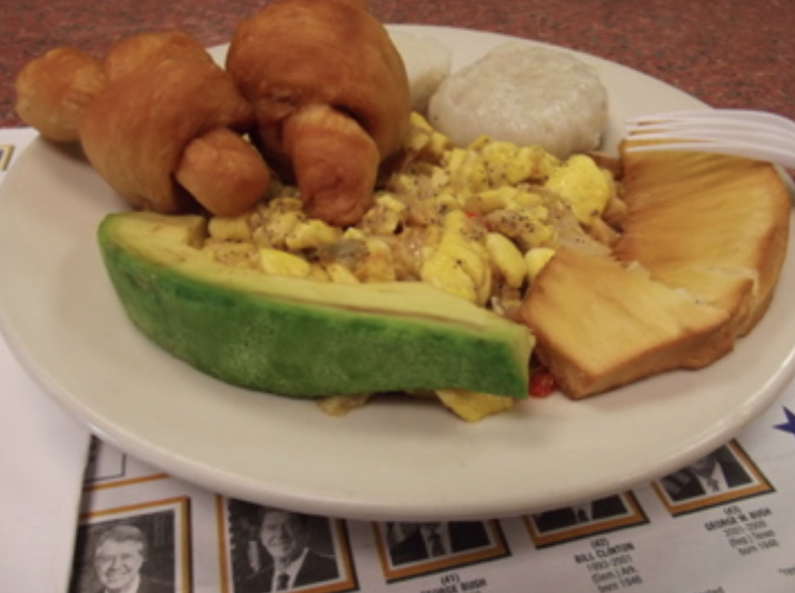 Breakfast (Jamaica) of ackee, salt fish, dumplings, Festival, roasted breadfruit and avocado