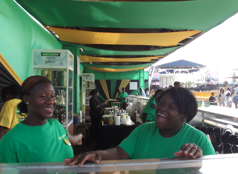 Two women enjoying a laugh at a Jamaica 50 event